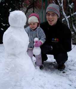Avery and Daddy with a snowman and snowbaby
