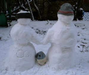 snow family with hats on
