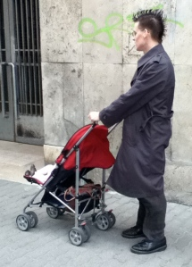 The bemohawked stroller-pusher
