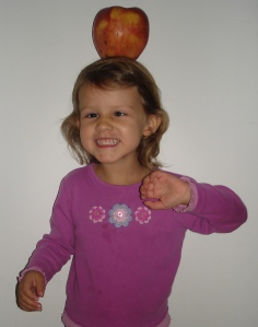 Avery with a big apple on her head