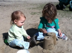 Avery and Evelyn intent on constructing their towers.